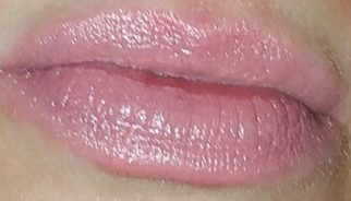 Coola Mineral Liplux SPF 30 in Nude Beach swatched on lips with flash