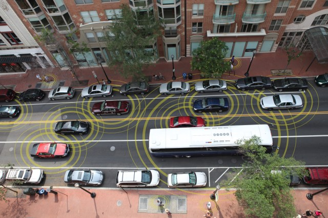 "An artist's conception visualizes how ""connected vehicles"" could communicate. (Credit: USDOT)"