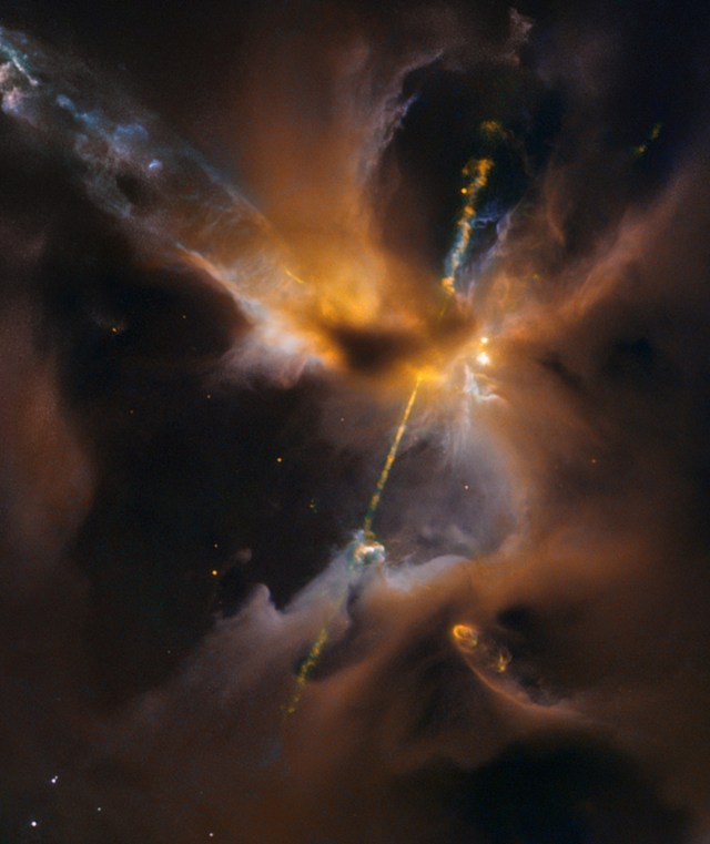 An image from the Hubble Space Telescope focuses on jets of hot gas blazing forth from a protostar in the middle of a dusty cloud known as Herbig-Haro 24. (Credit: NASA / ESA)