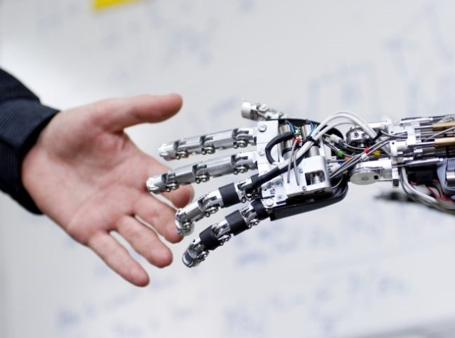 Image: Human and machine hand
