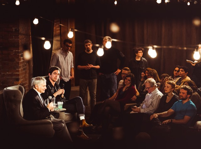SETI astronomer Seth Shostak (far left) takes questions from the audience while The Goodship Company's art director, Greg Lundgren, looks on. GeekWire's Alan Boyle is the guy with his head down in the front row. (Goodship Photo / Ben Lindbloom)