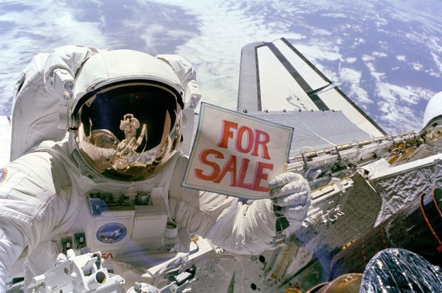 """For Sale"" sign in space"