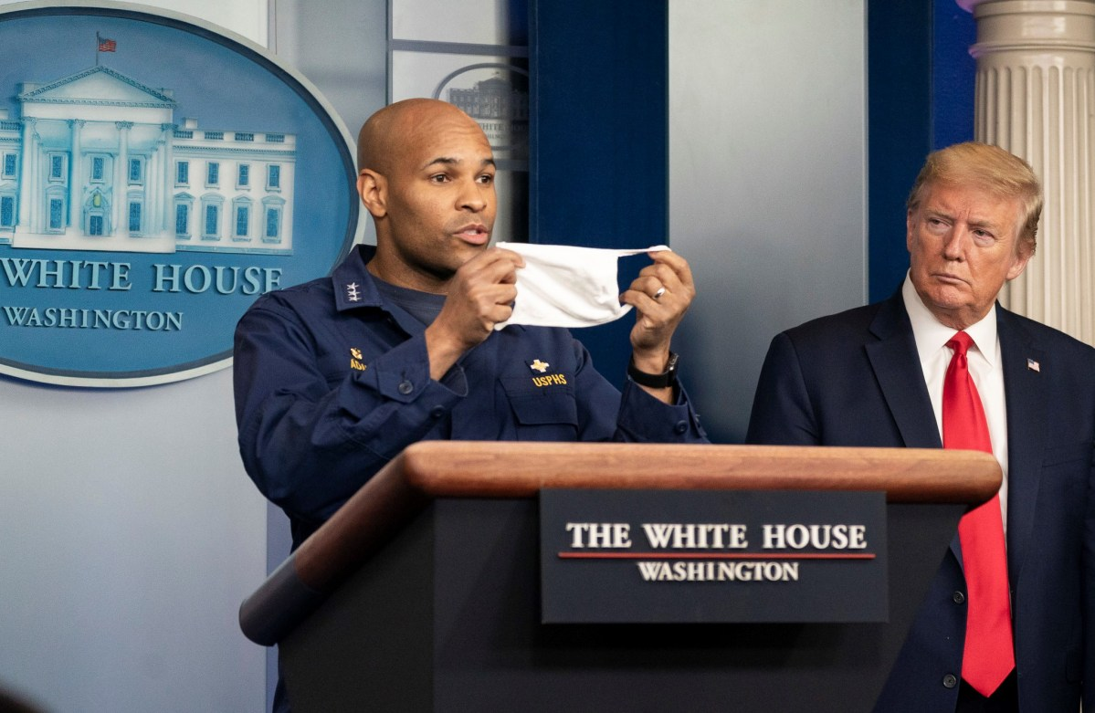 Surgeon General Jerome Adams and President Donald Trump