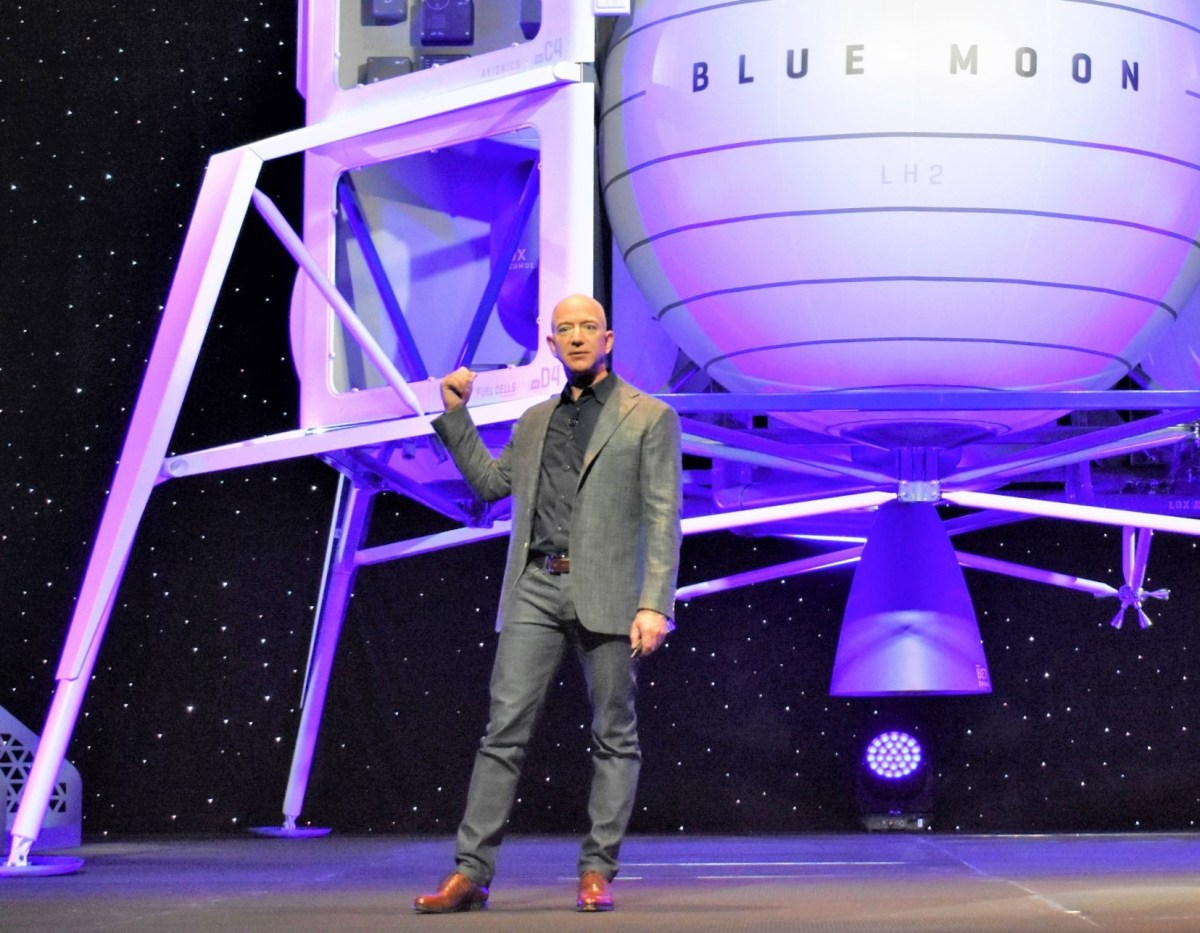 Jeff Bezos with lunar lander mockup