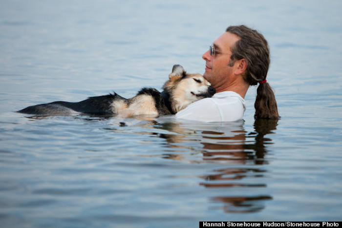 Schoep and John - man and dog swimming in Lake Superior