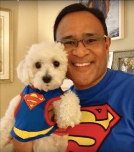 Dad and dog in superman costume