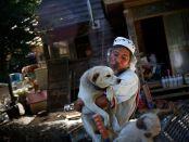 Keigo Sakamoto holding one of his dogs
