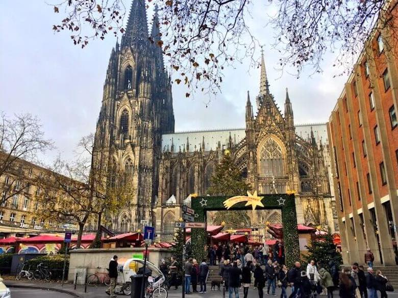 Christmas market in Cologne, Germany, with the Dom cathedral in the backdrop