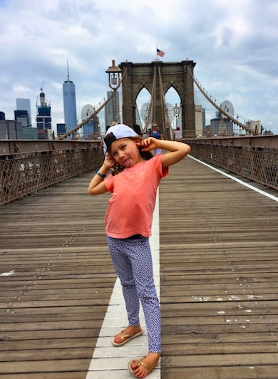 CosmopoliClan's girl Alegra looking cool on Brooklyn Bridge with a view of the Manhattan skyline