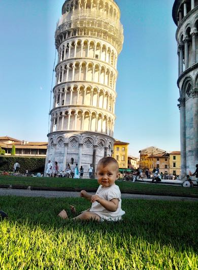 Baby girl in front of the Pisa tower in ITaly
