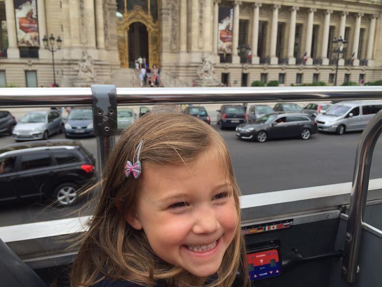 Alegra riding the open bus and arriving at the Opera Garnier in Paris