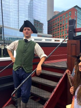 A customer historic figure aboard one of the restored ships of the Boston Tea Party Museum