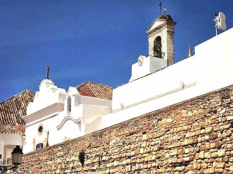 Ancient city wall encompassing the historic center of Faro in authentic Algarve in Portugal