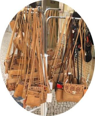 A rack of cork handbags in a souvenirshop in Loule in authentic Algarve in Portugal