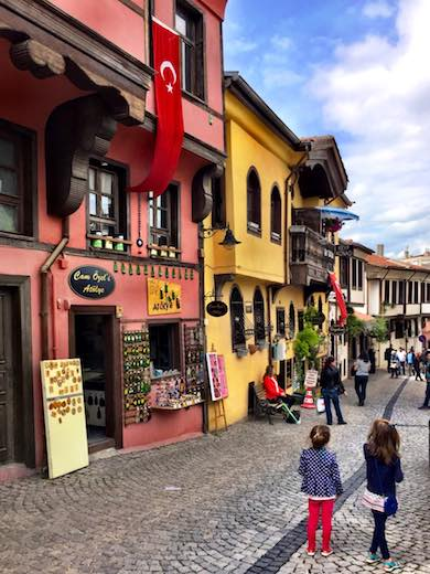 Two girls admiring the konaks and souvenir shops in in colorful Odunpazarı in Turkish Eskişehir