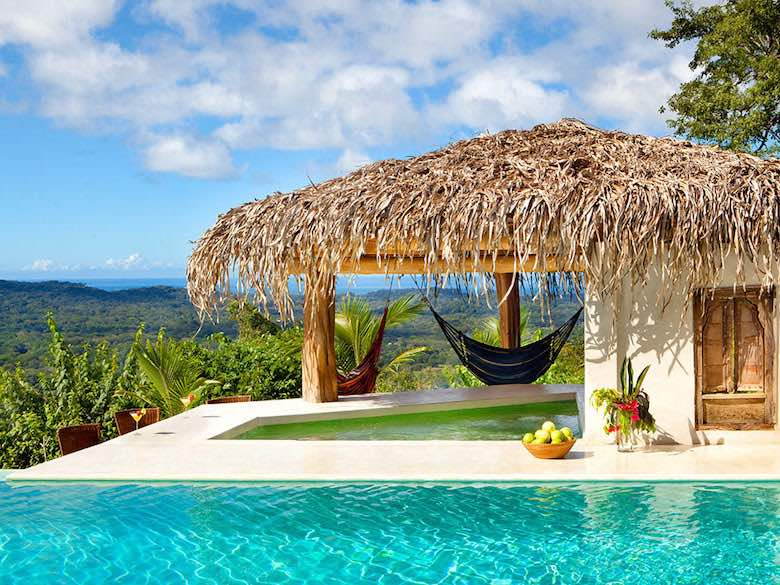 A poolside hammock in Casa Finca Austria Nosara Estate in Costa Rica, available via Luxury Retreats