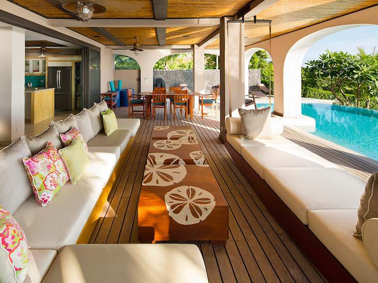 Covered seating area near the pool in Villa Floramar in Costa Rica, available via Luxury Retreats