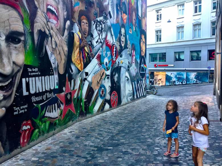 Admiring the rock-themed street art in the streets of Basel