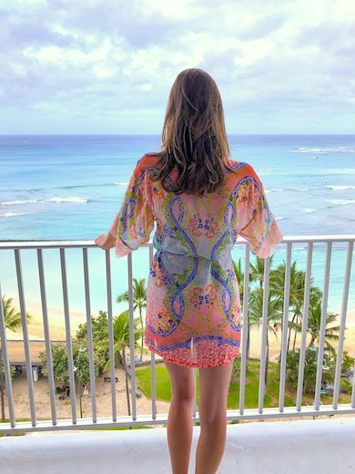 CosmopoliMom overlooking Waikiki Beach from the private lanai of a Premier Ocean Front room in the Beachside tower of the Alohilani Resort in Waikiki Beach