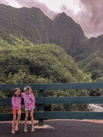 Two little girls having fun at 'Iao Valley, one of the stops on our Maui road trip with kids