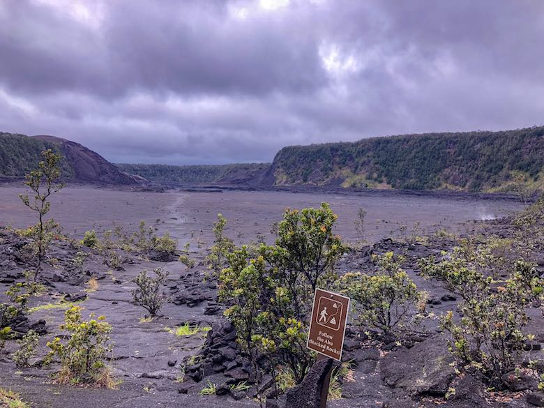 Looking over the crater lake of the Kilauea Iki Trail, the best Big Island Hike in Hawaii Volcanoes National Park