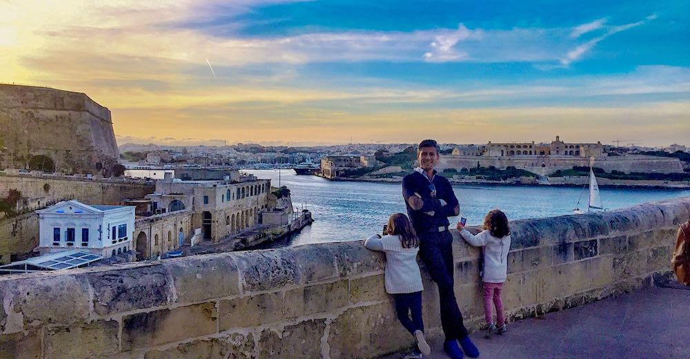 A dad and his two little daughters waiting for the watertaxi from Valletta to Sliema while enjoying the gorgeous views