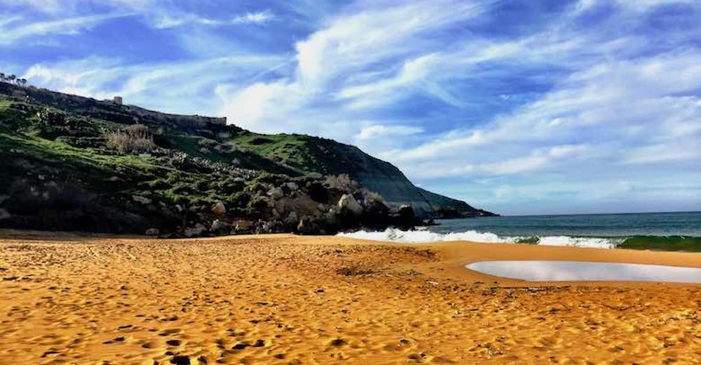 Ramla I-Hamra or Ramla Bay on Gozo island offers one of the most stunning places to visit in Malta
