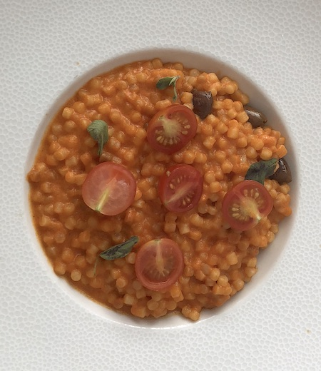 Frégola sarda risotto with tomatoes at the La Véranda byGordon Ramsey restaurant in the Trianon Palace Versailles, a Waldorf Astoria Hotel