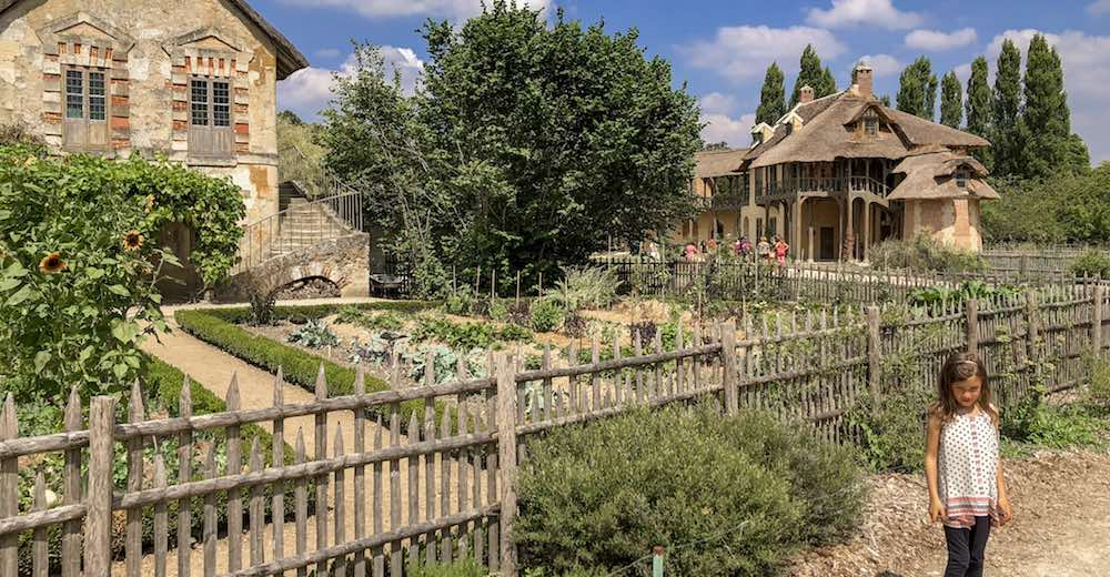 Vegetable and herb gardens at the Queen's Hamlet or Hameau de la Reine on the Petit Trianon while visiting Versailles