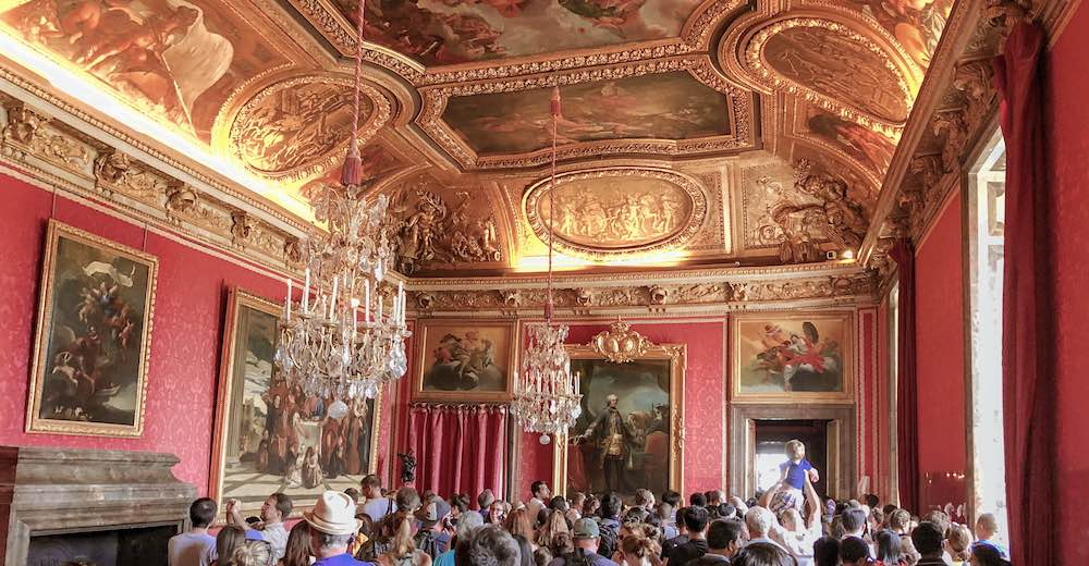 Crowds admiring the Grand Apartments at the Palace of Versailles