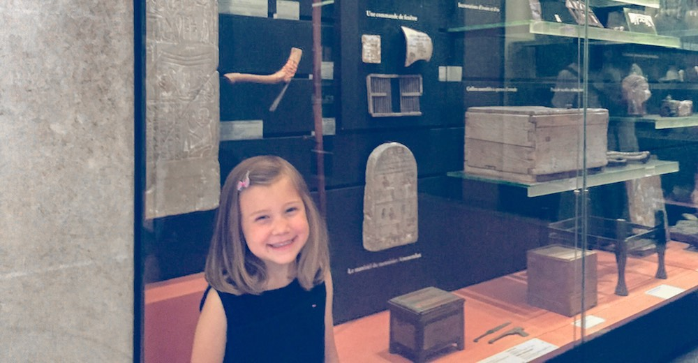 Little girl visiting the Louvre's Antiquities section during our Paris itinerary