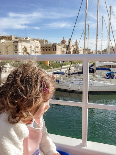 Little girl on a water taxi from Three Cities to Valletta