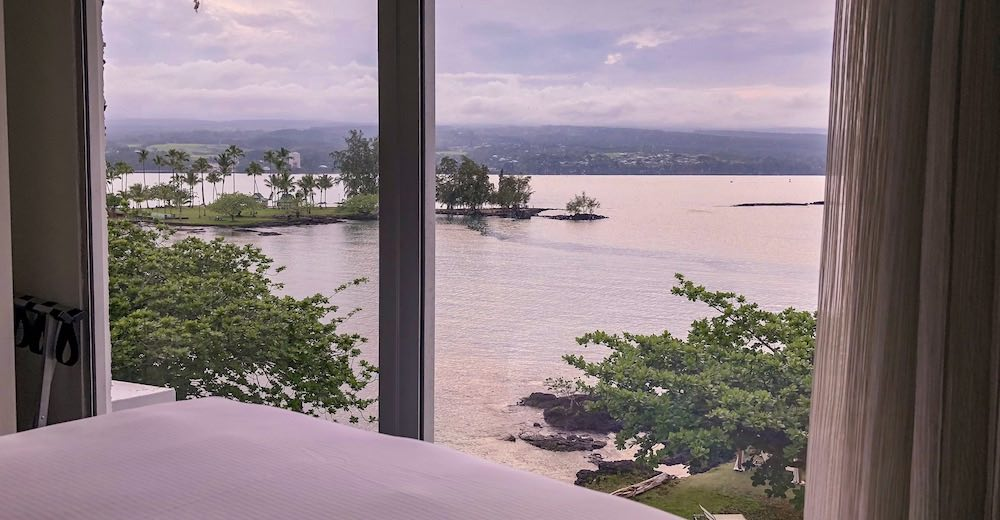 View over Hilo Bay from a room at the Grand Naniloa Hotel near the Big Island waterfalls