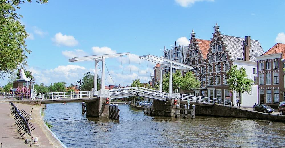 Behind the bridge, you'll see two houses with identical roofs that once housed the famous De Olyphant brewery of Haarlem Netherlands