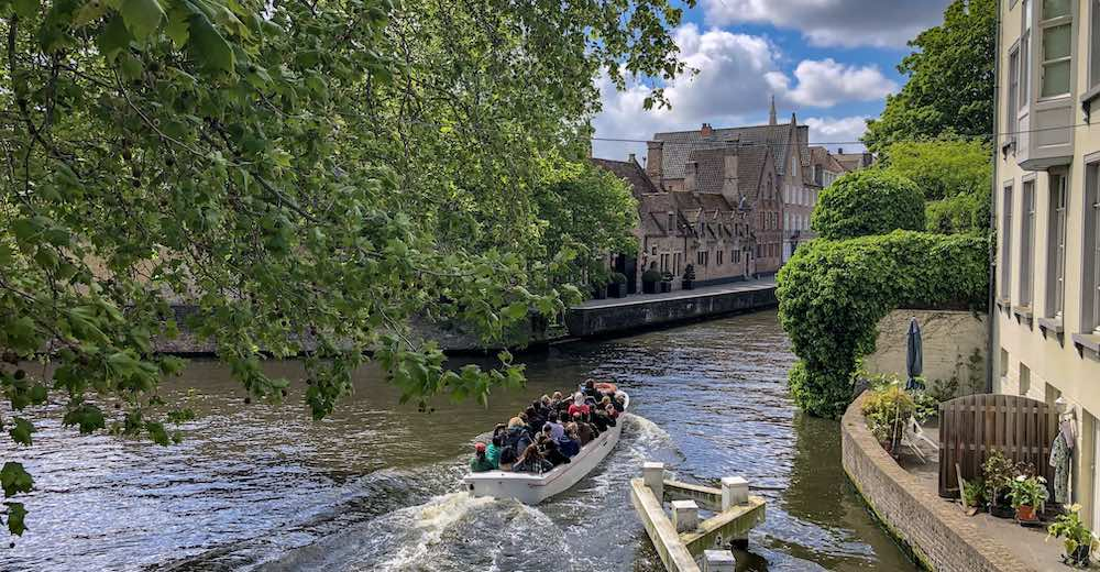 Canal tour in historic Bruges, one of the best day trips from Brussels Belgium