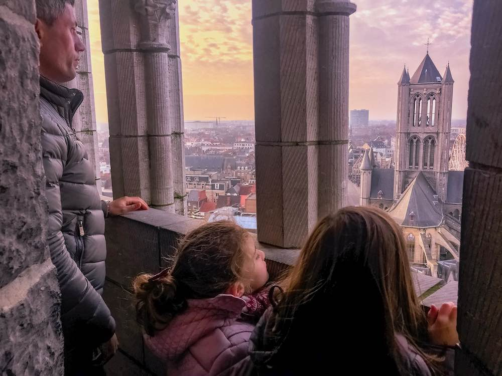 Sunset views over the city from the Ghent Belfry, climbing the steps to the tower is one of the best things to do in Ghent