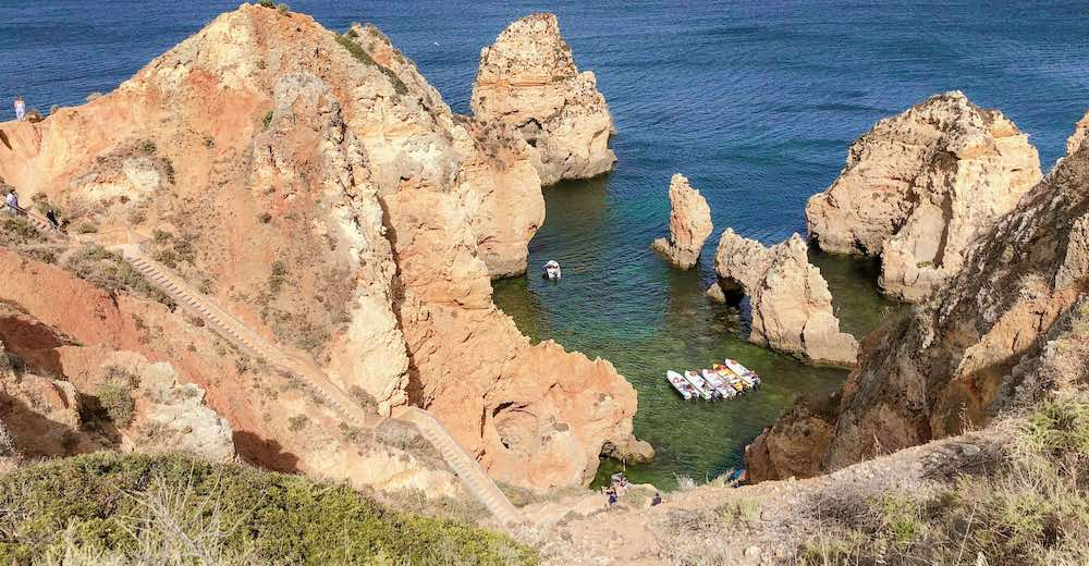 Visiting the Ponta da Piedade rock formations along the Algarve coastline is one of the best things to do in Lagos Portugal