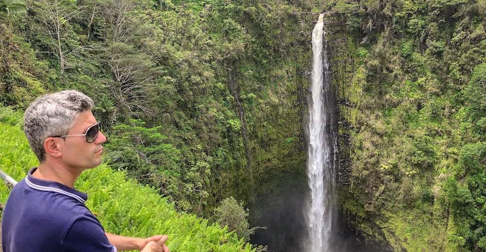 Man enjoying the view at ʻAkaka Falls state park Hawaii Big Island waterfalls