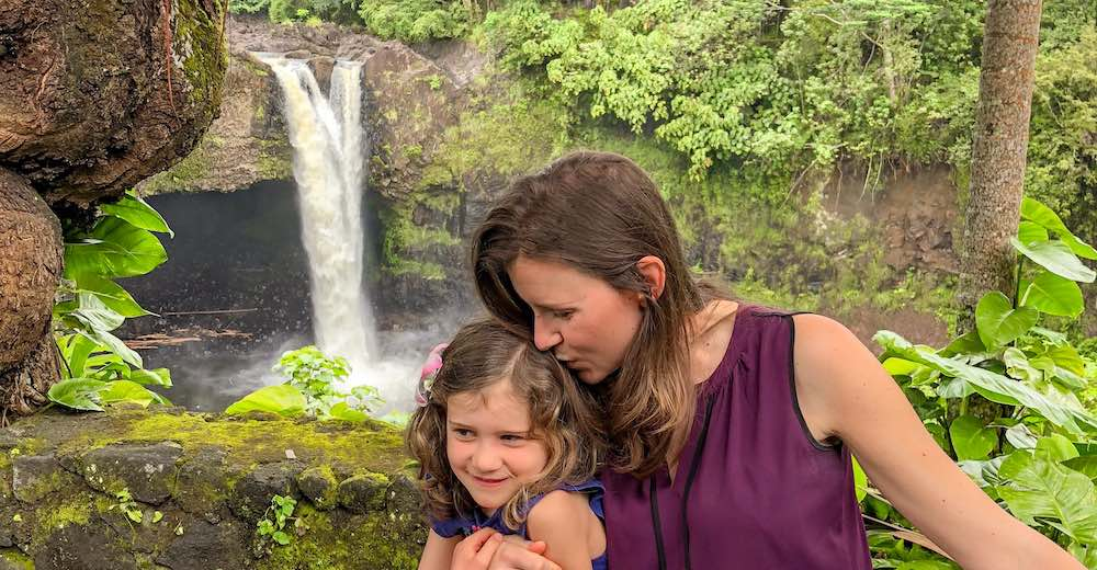 Mother and daughter near Rainbow Falls Hawaii, one of the best waterfalls on Big Island