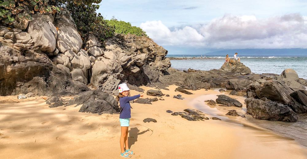 Little girl on Kapalua beach which is one of the best places to stay in Maui