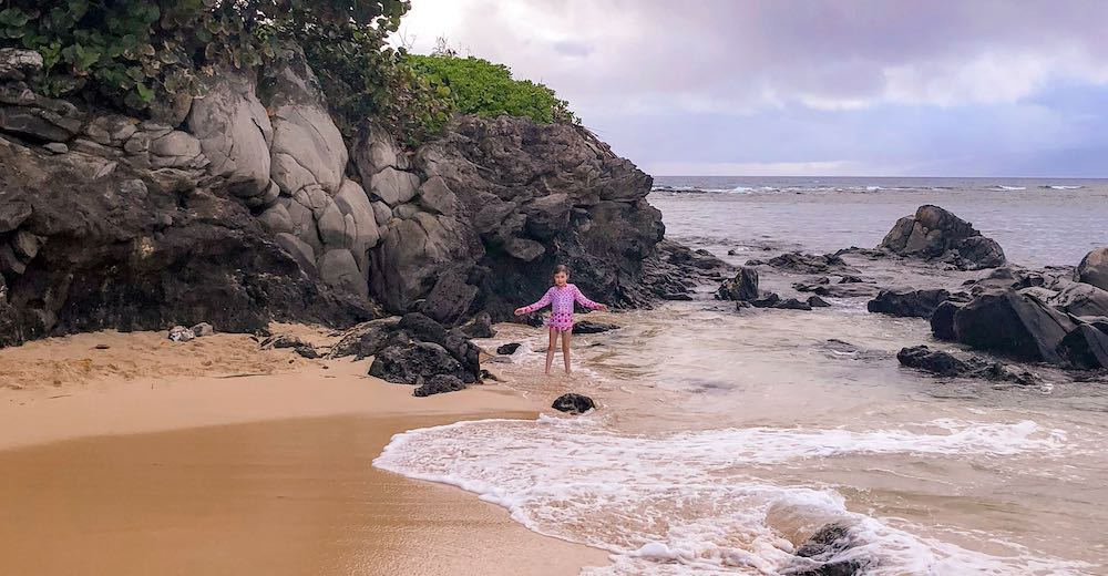 Little girl during a rainy moment at Kapalua beach