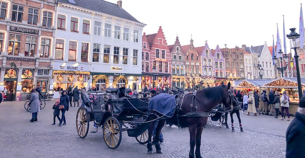 A hors-carriage ride is an essential thing to do when celebrating Christmas in Bruges