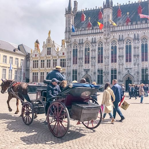 Horse-drawn carriage on Burg square in Bruges, one of the best cities in Belgium
