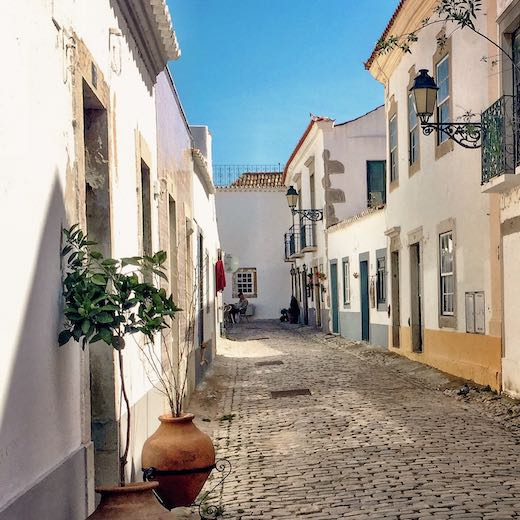 If you wonder where to stay in Algarve Portugal then consider the quaint streets of Faro