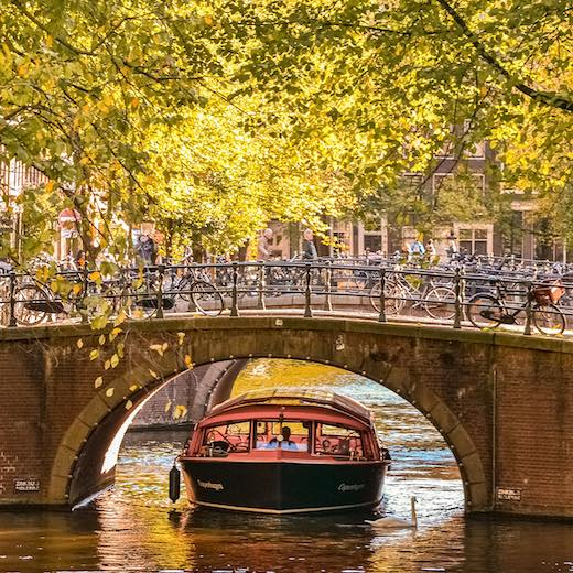 Canal boat passing through one of the bridges in Amsterdam