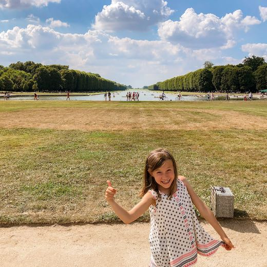 Little girl visiting Versailles from Paris