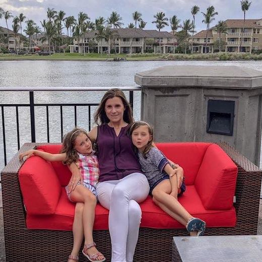 Mother and her two daughters in a red sofa at Waikoloa on Big Island Hawaii