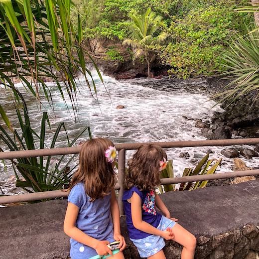 Hawaii best island for families that love the lush nature like these girls at Onomea Bay