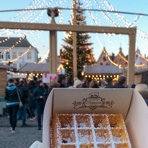 Brussel waffles in Bruges with Christmas festivities in the backdrop