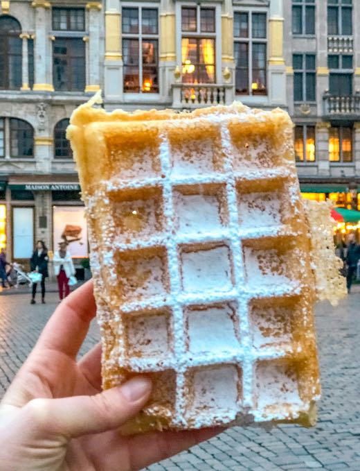 The rectangular Brussels waffle against the backdrop of the Grand Place